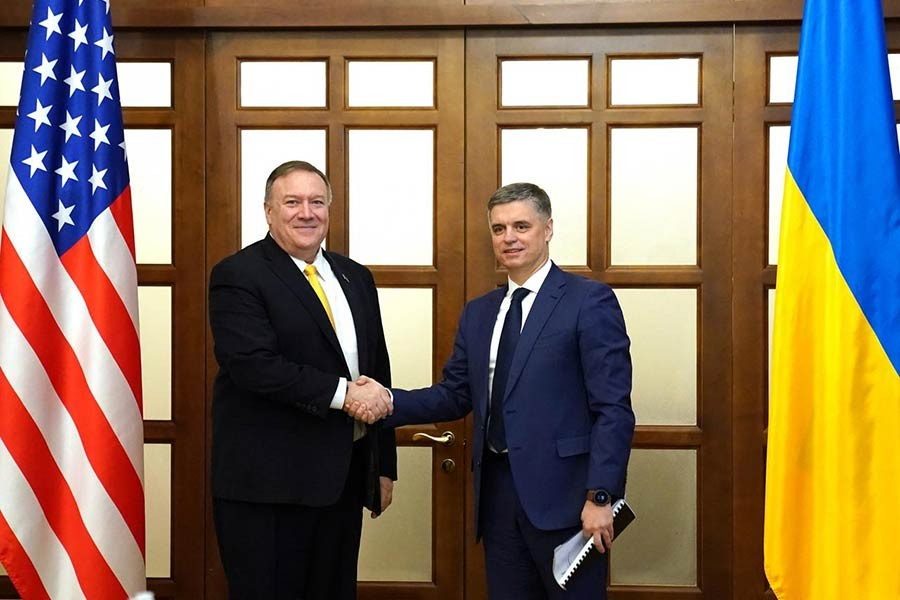 US Secretary of State Mike Pompeo shaking hands with Ukraine's President Volodymyr Zelensky at a meeting in Kiev, Ukraine, on Friday. -Reuters Photo