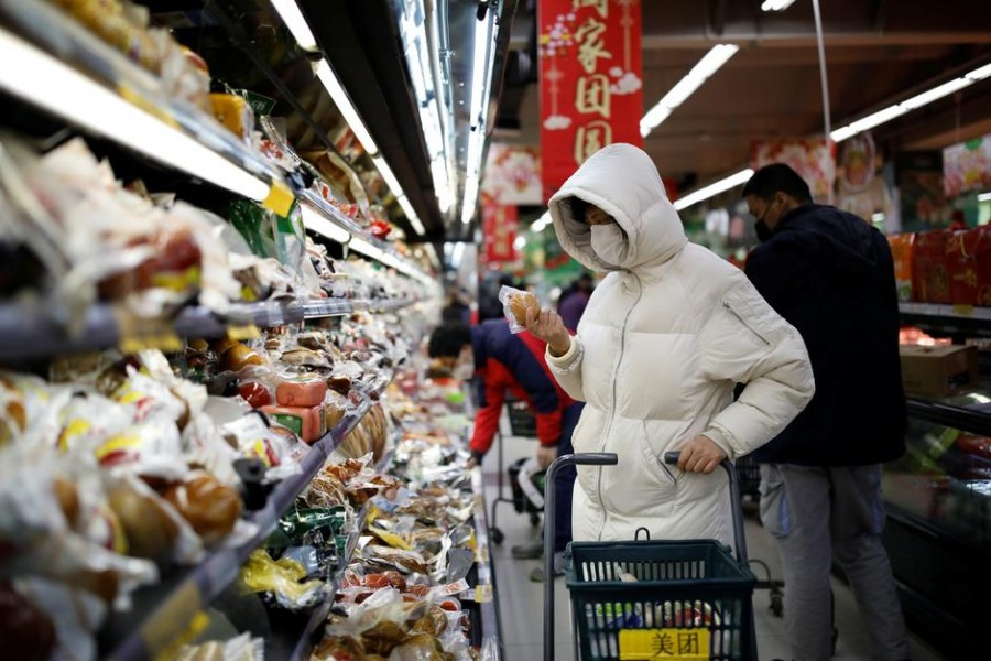 People wearing face masks look for products at a supermarket, as the country is hit by an outbreak of the new coronavirus, in Beijing, China, January 31, 2020. Reuters