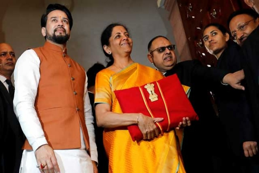 India's finance minister Nirmala Sitharaman is flanked by junior Finance Minister Anurag Thakur as she arrives to present the budget in Parliament in New Delhi, India, February 01, 2020. Reuters