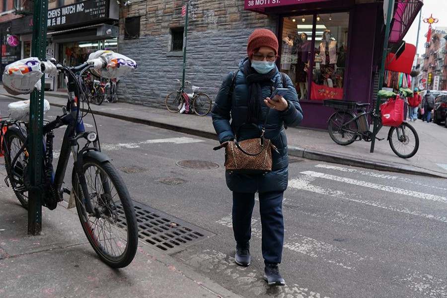A resident of Chinatown wears a surgical mask in New York City, US on January 31, 2020 — Reuters photo