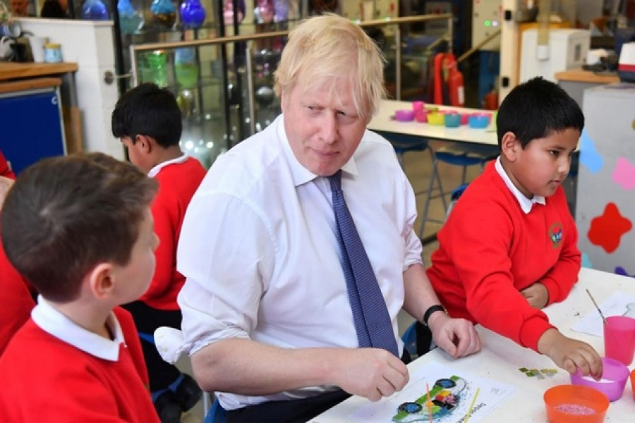 Britain's prime minister Boris Johnson participates in a workshop with children from the Richard Avenue Primary School prior to chairing a cabinet meeting at the National Glass Centre at the University of Sunderland, Sunderland, Britain, January 31, 2020. Reuters