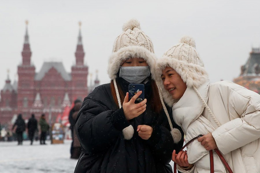 Young women are pictured wearing a medical mask in Red Square in Moscow, Russia on January 28, 2020 — Reuters photo