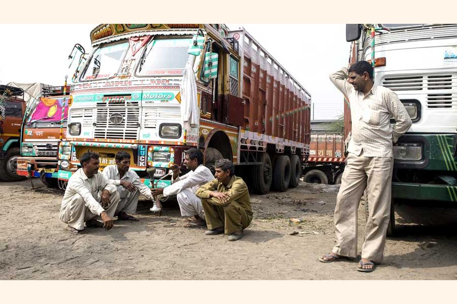 Indian truck drivers waiting at the Benapole Land Port truck terminal for their turn to unload the goods. The photo was taken on Monday     	— FE Photo