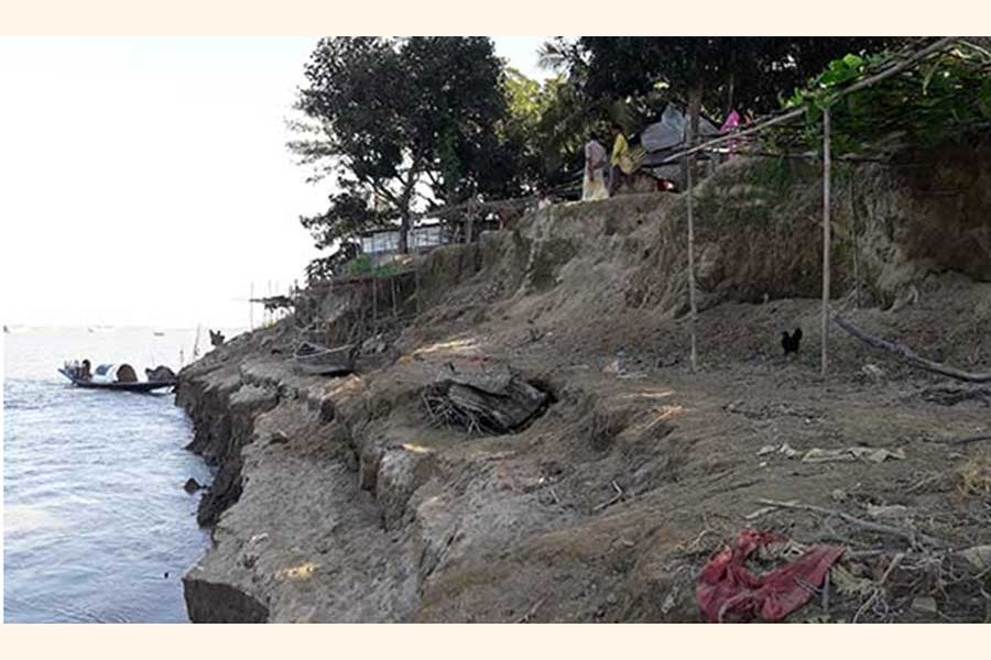 Erosion by the Dhanu river under Khaliajuri upazila of Netrakona district takes a serious turn	— FE Photo