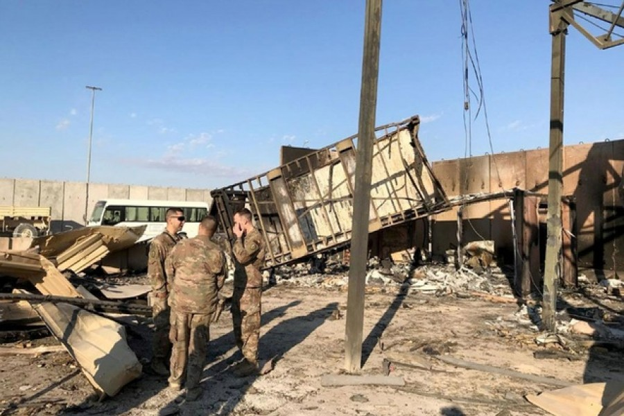 US soldiers are seen at the site where an Iranian missile hit at Ain al-Asad air base in Anbar province, Iraq Jan 13, 2020. REUTERS/John Davison