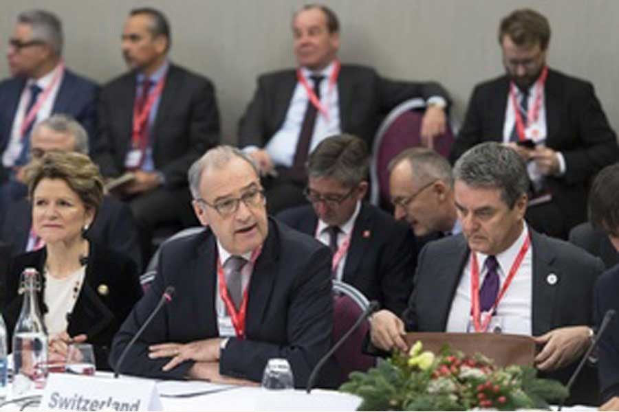 The Swiss economics minister, Guy Parmelin (centre), chaired the ministerial  WTO meeting in Davos on January 24, 2020. Seventeen World Trade Organisation (WTO) members, including Switzerland, the European Union and China, have agreed to create a temporary mechanism to settle international trade disputes. The move comes after the United States paralysed the WTO Appellate Body last month, throwing the Geneva-based organisation into crisis.         —Credit: swissinfo.ch via the internet