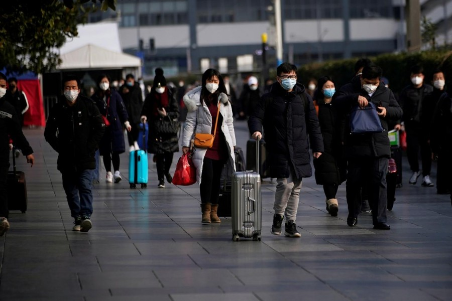 Passengers wearing masks walk at the Shanghai railway station in China, as the country is hit by an outbreak of the novel coronavirus, February 9, 2020. Reuters