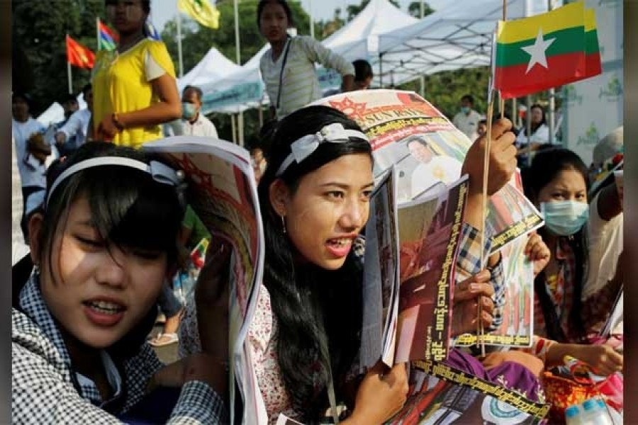 Participants carry Myanmar flags during a nationalist rally in Yangon, Myanmar, February 09, 2020. Reuters
