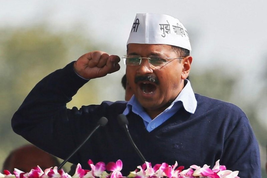 Arvind Kejriwal, chief of Aam Aadmi (Common Man) Party (AAP), addresses his supporters after taking the oath as the new chief minister of Delhi during a swearing-in ceremony at Ramlila ground in New Delhi February 14, 2015. REUTERS/Anindito Mukherjee/Files