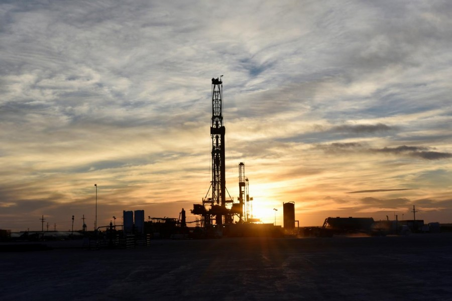 Drilling rigs operate at sunset in Midland, Texas, US, February 13, 2019.Reuters/File Photo