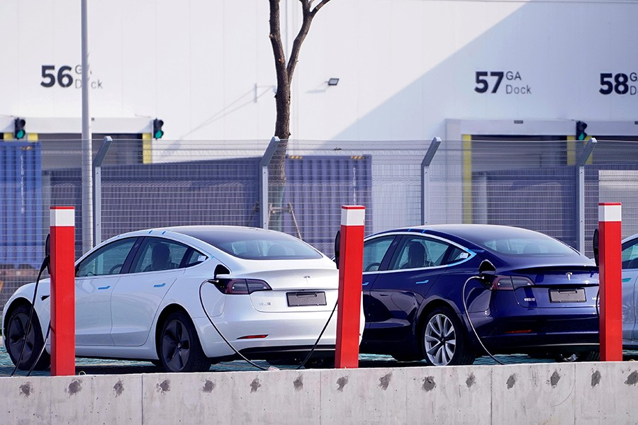 China-made Tesla Model 3 electric vehicles are seen at the Gigafactory of electric car maker Tesla in Shanghai, China on December 2, 2019 — Reuters/Files
