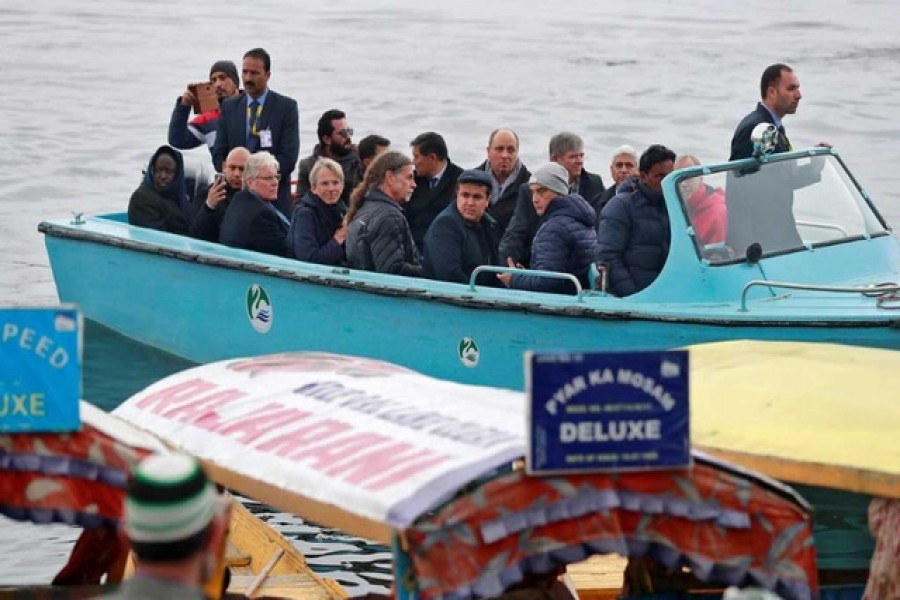 Foreign diplomats are seen in a motorboat in Dal Lake in Srinagar, February 12, 2020. Reuters
