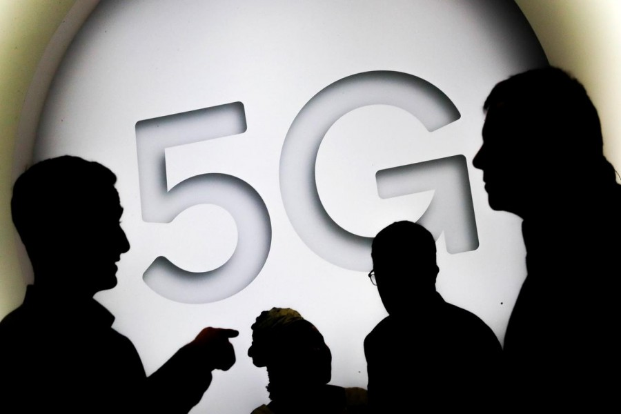 FILE PHOTO: A 5G sign is seen at the Mobile World Congress in Barcelona, Spain February 28, 2018. REUTERS/Yves Herman