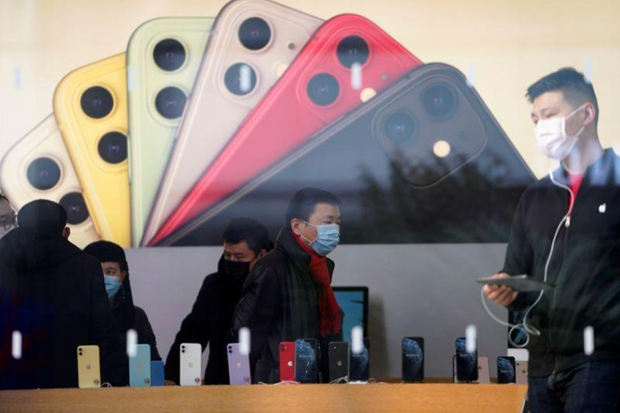 People wearing protective masks are seen in an Apple Store, as China is hit by an outbreak of the new coronavirus, in Shanghai, China on January 29, 2020 — Reuters/Files
