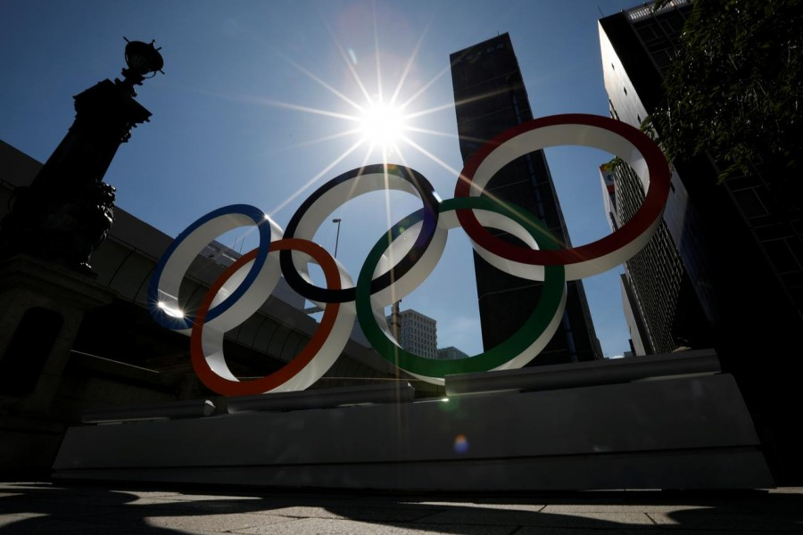FILE PHOTO: Summer sunshine is seen through Olympic rings displayed at Nihonbashi district in Tokyo, Japan August 5, 2019. REUTERS/Issei Kato