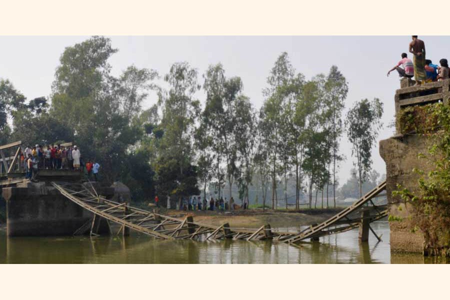 The bailey bridge over the Garamara Canal at Mahatpara village on Dhunat-Sherpur road in Bogura collapsed recently  	— FE Photo