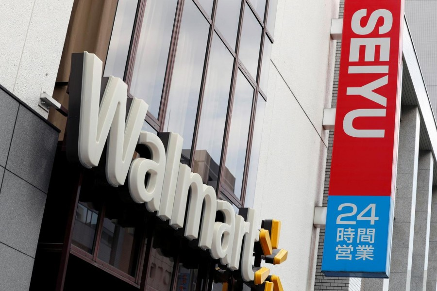 FILE PHOTO: The logos of Walmart and Seiyu are pictured at the headquarters office in Tokyo, Japan July 12, 2018. REUTERS/Kim Kyung-Hoon