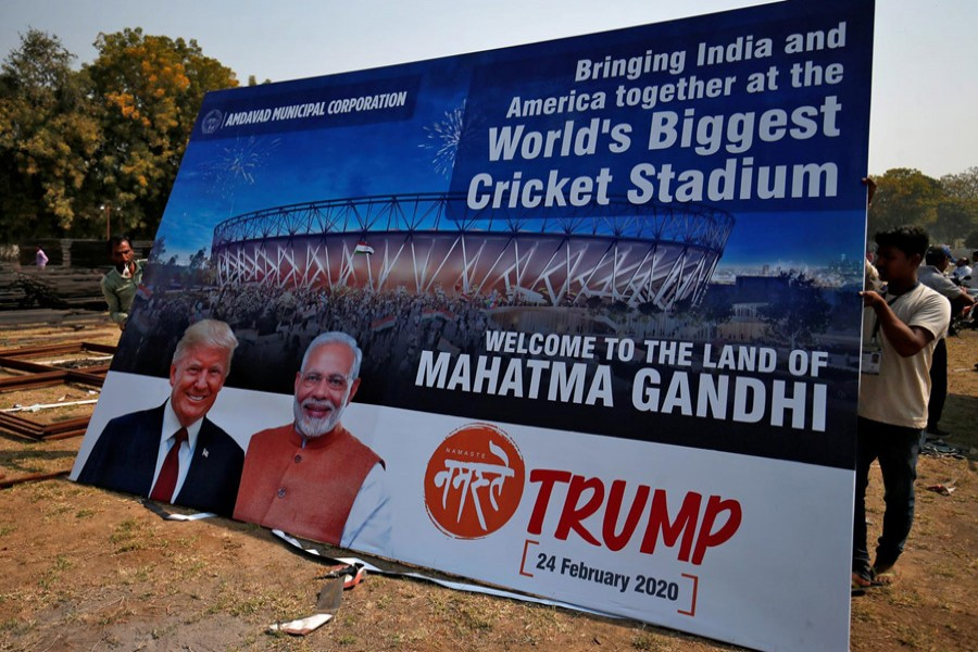 Workers prepare a hoarding with the images of the US president Donald Trump and India's prime minister Narendra Modi ahead of Trump's visit, on the outskirts of Ahmedabad, India, February 19, 2020. Reuters