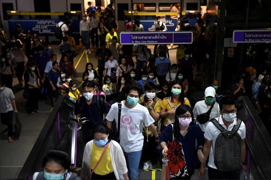 Commuters wearing protective masks as they walk inside the MRT subway in Bangkok, Thailand on February 24, 2020 — Reuters photo