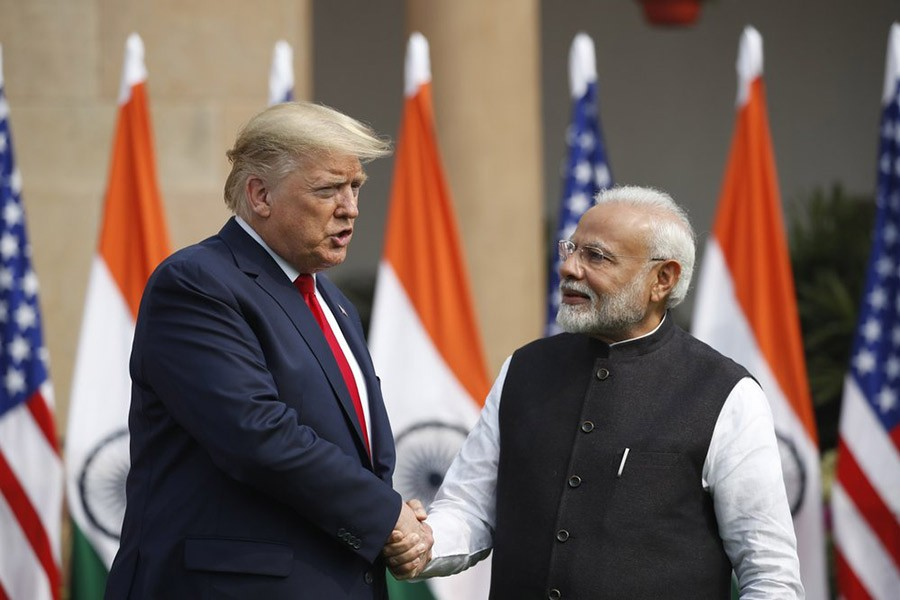 US President Donald Trump and Indian Prime Minister Narendra Modi shaking hands before their meeting at Hyderabad House in New Delhi, India, on Tuesday. -AP Photo