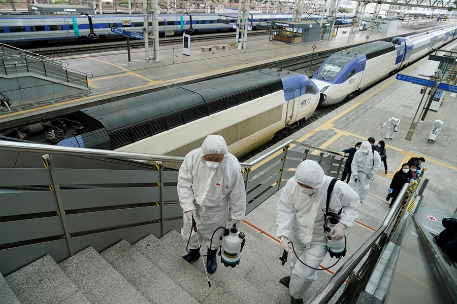 Employees from a disinfection service company sanitise the floor of Seoul Railway Station in Seoul, South Korea on February 25, 2020 — Reuters photo
