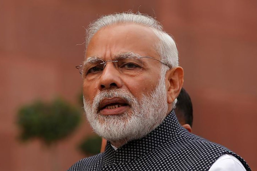 Death toll rises to 20 from riots, Modi appeals for calm