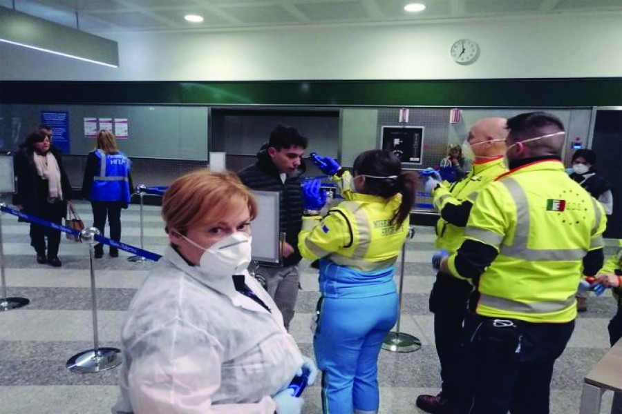"Civil protection volunteers engaged in health checks at the ""Milano Malpensa"" airport. This week a joint team between WHO and the European Centre for Disease Prevention and Control arrived in Rome to review the public health measures put in place to prevent the spread of the coronavirus. 	—Courtesy: Dipartimento Protezione Civile"