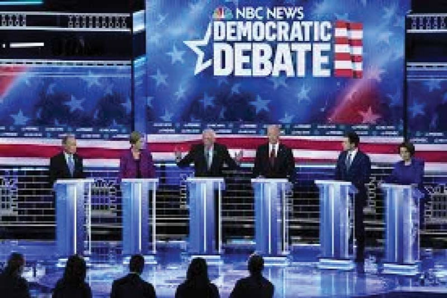 WARREN DOUBLES DOWN ON CRITICISING BLOOMBERG AS US DEMOCRATS SPRINT TO SUPER TUESDAY: Senator Bernie Sanders speaks as his rivals for the 2020 Democratic presidential nomination listen at the ninth Democratic 2020 US Presidential candidates debate at the Paris Theater in Las Vegas Nevada, US on February 19, 2020.       —Photo: Reuters