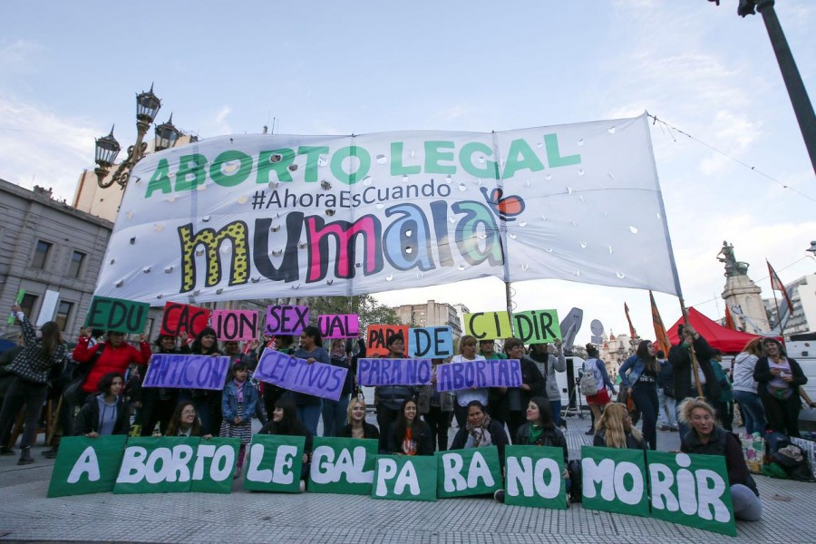 FILE PHOTO: Activists hold a banner as they take part in a rally in favour of legalising abortion, in Buenos Aires, Argentina September 27, 2019. REUTERS/Agustin Marcarian/File Photo