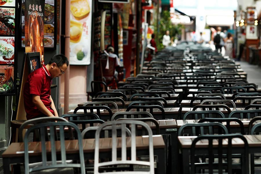 A restaurant promoter waiting for customers at the largely empty Chinatown as tourism takes a decline due to the coronavirus outbreak in Singapore. The photo was taken on February 21. -Reuters Photo