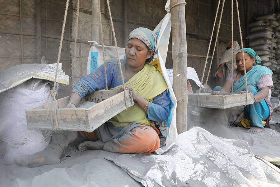 Women working at an aluminium recycling factory at Jhilpar in Keraniganj's Hasnabad area near the city on Saturday — FE photo by Shafiqul Alam