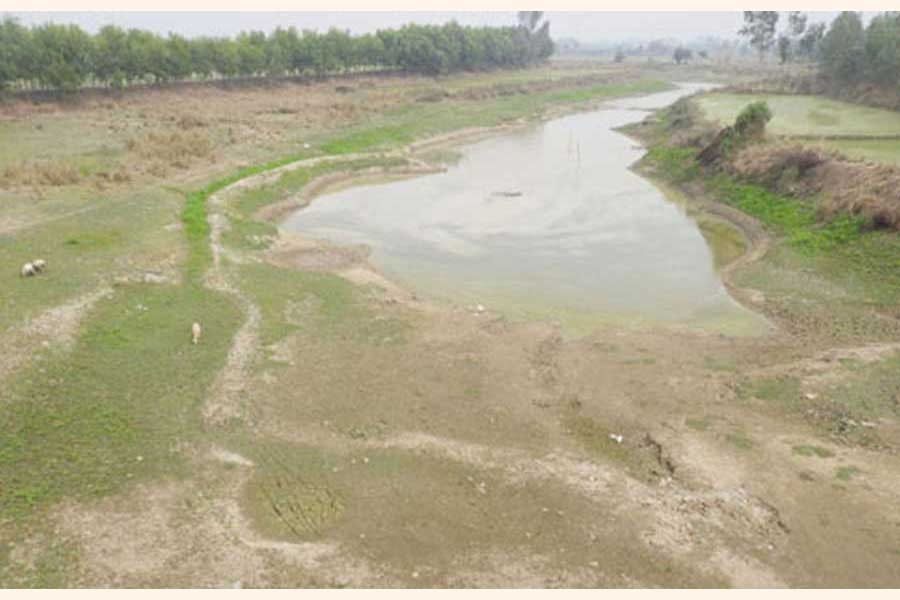 A poor state of the Nagore river in Bogura district	— FE Photo