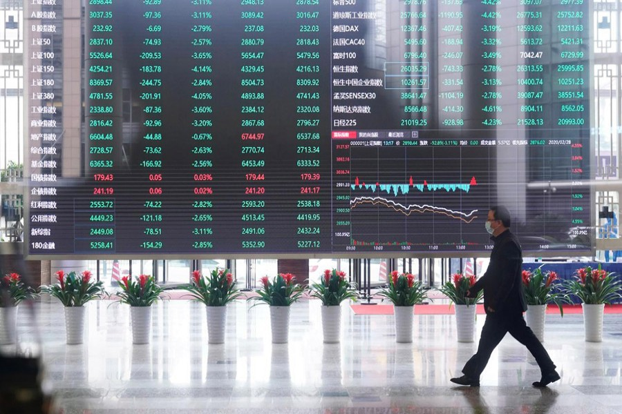 A man wearing a face mask is seen inside the Shanghai Stock Exchange building, as the country is hit by a novel coronavirus outbreak, at the Pudong financial district in Shanghai, China, February 28, 2020 — Reuters/Files