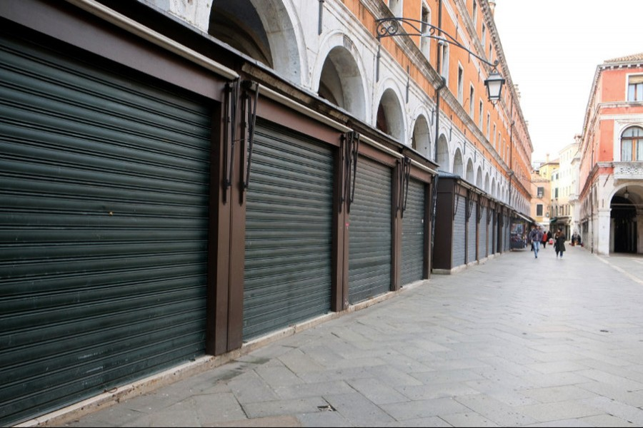 Shops are shuttered on an empty street in Venice on March 9, 2020 — Reuters photo