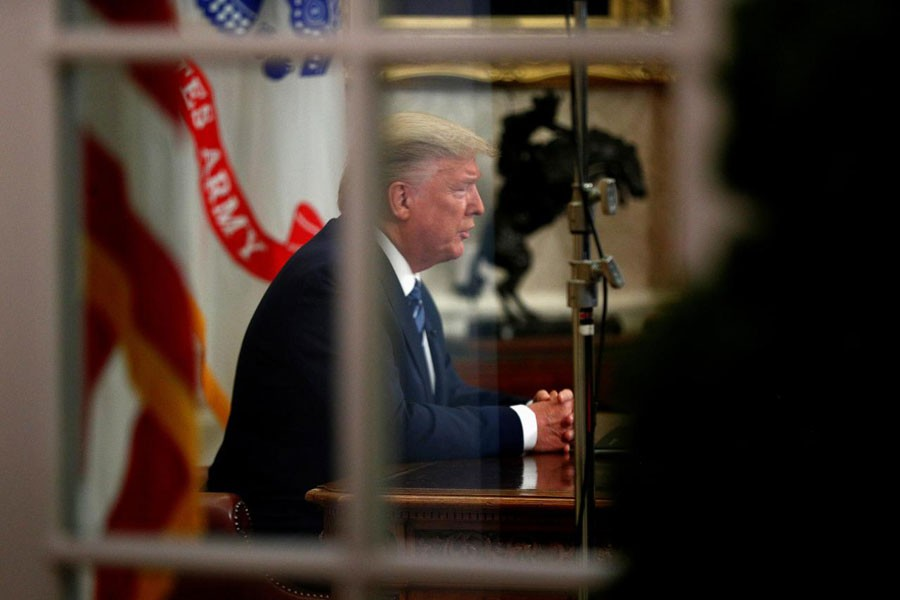US President Donald Trump addresses the nation during a live television broadcast regarding the COVID-19 coronavirus pandemic, from inside the Oval Office at the White House in Washington, U.S., March 11, 2020: All global investors got from US President Donald Trump's coronavirus package were a shock travel ban on Europe and a flashing signal to sell, and none of the large-scale tax breaks or medical tests for Americans they'd been expecting. The deep disappointment with Trump's much-touted plan, which he unveiled late on Wednesday, spurred massive falls in global stock markets. US stock index futures ESc1 plunged nearly 5.0 per cent, almost hitting their circuit breakers for the second time in a week           —Reuters