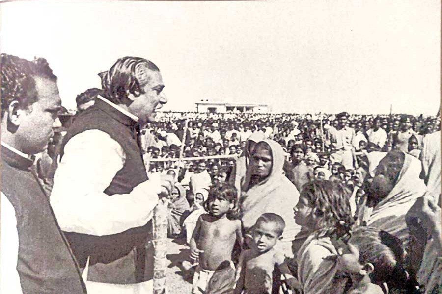 Bangabandhu Sheikh Mujibur Rahman among the cyclone affected people, listening to the stories of their suffering (1974) — mujib100.gov.bd