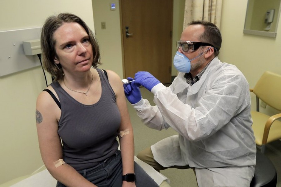 A pharmacist gives Jennifer Haller, left, the first shot in the first-stage safety study clinical trial of a potential vaccine for COVID-19, the disease caused by the new coronavirus, Monday, March 16, 2020, at the Kaiser Permanente Washington Health Research Institute in Seattle. —AP