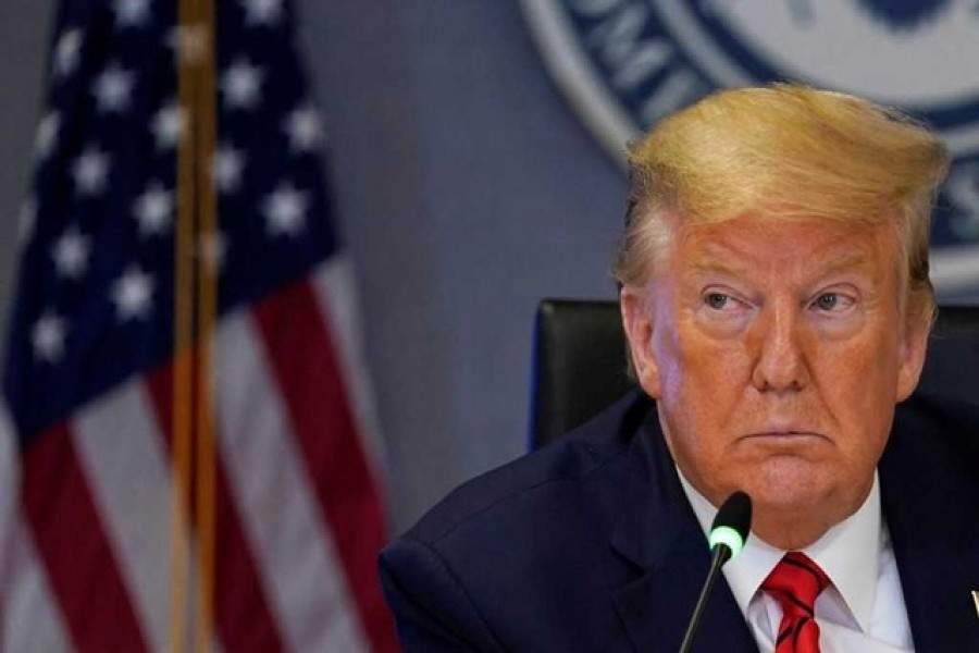 """US president Donald Trump attends a teleconference with governors to discuss partnerships to prepare, mitigate and respond to COVID-19"""" at the headquarters of the Federal Emergency Management Agency (FEMA) amid coronavirus fears, in Washington, US, March 19, 2020. — Reuters"""
