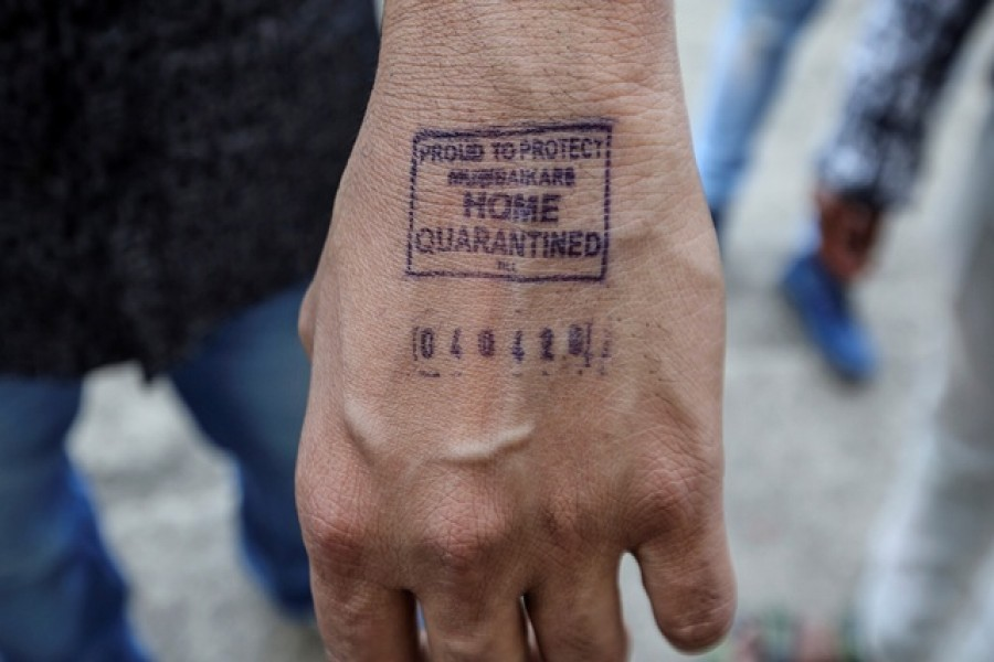 A man shows his hand which was stamped by airport authorities as he was advised for home quarantine after he arrived from overseas, amid coronavirus disease (COVID-19) fears, in Mumbai, India, March 21, 2020. — Reuters