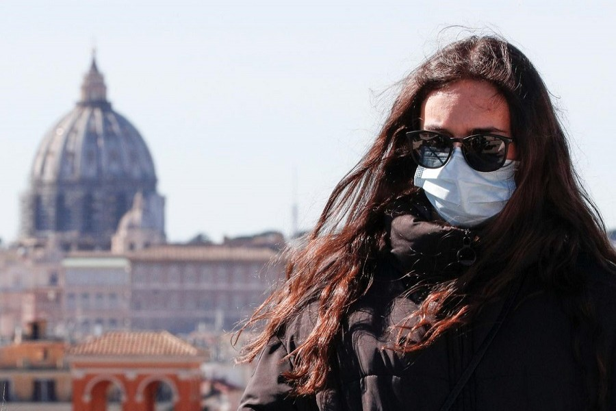 A woman wears a protective mask in downtown Rome, Italy, February 28, 2020. — Reuters/Files