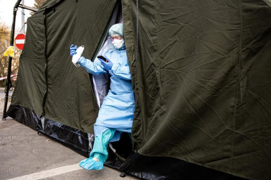A doctor in protective suite leaves a special tent for coronavirus disease cases near a hospital in Lublin, Poland on March 23, 2020 — Reuters photo