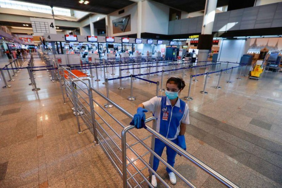 World News March 11, 2020 / 1:23 PM / 14 days ago Thailand restricts visitor visas to limit virus spread  3 Min Read  BANGKOK (Reuters) - Thailand will temporarily suspend issuing visas on arrival to visitors from 19 countries and territories, including China, to contain the spread of the coronavirus, its interior minister said on Wednesday. A worker cleans near check-in counters for international flights are seen empty due to the coronavirus outbreak at Don Mueang Airport in Bangkok, Thailand March 11, 2020. REUTERS/Soe Zeya Tun
