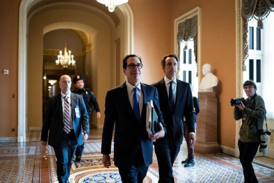 US secretary of the treasury Steven Mnuchin walks to a meeting during negotiations on a coronavirus disease (COVID-19) relief package on Capitol in Washington, March 24, 2020. — Reuters