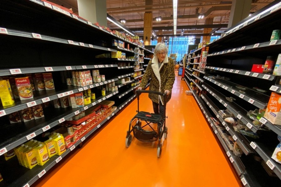 A shopper walks through an aisle empty of pasta, rice, beans and soup at a Loblaws supermarket in Toronto, Ontario, Canada, March 14, 2020. — Reuters/Files