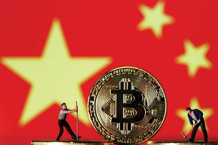 Mu Changchun, the head of the People's Bank of China's digital currency research institute, said China's new digital currency was different to bitcoin. —Photo: Reuters