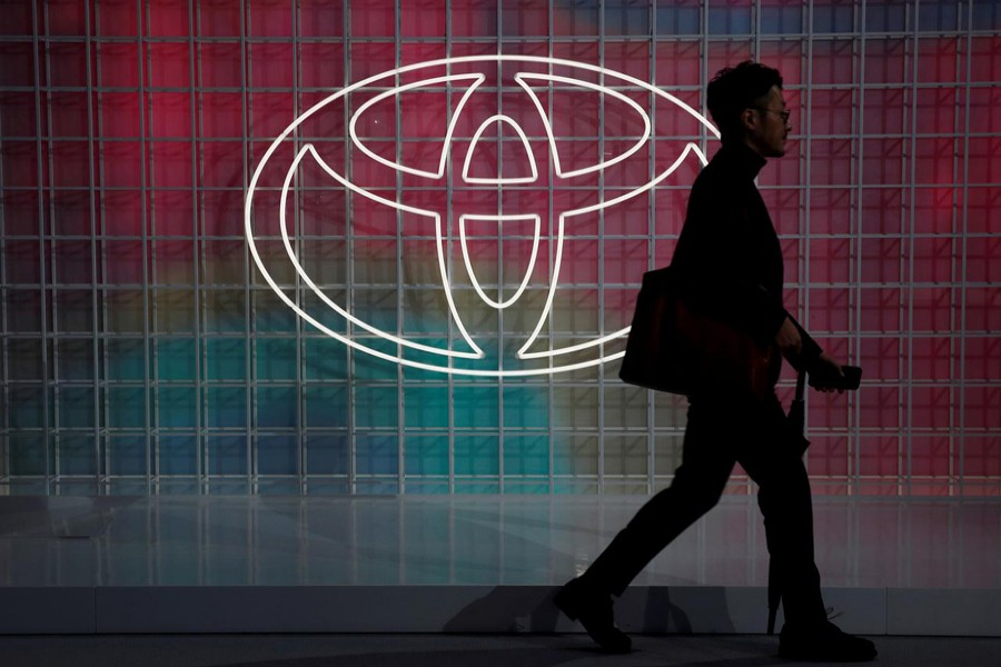 A man walks past a Toyota logo at the Tokyo Motor Show, in Tokyo, Japan on October 24, 2019 — Reuters/Files