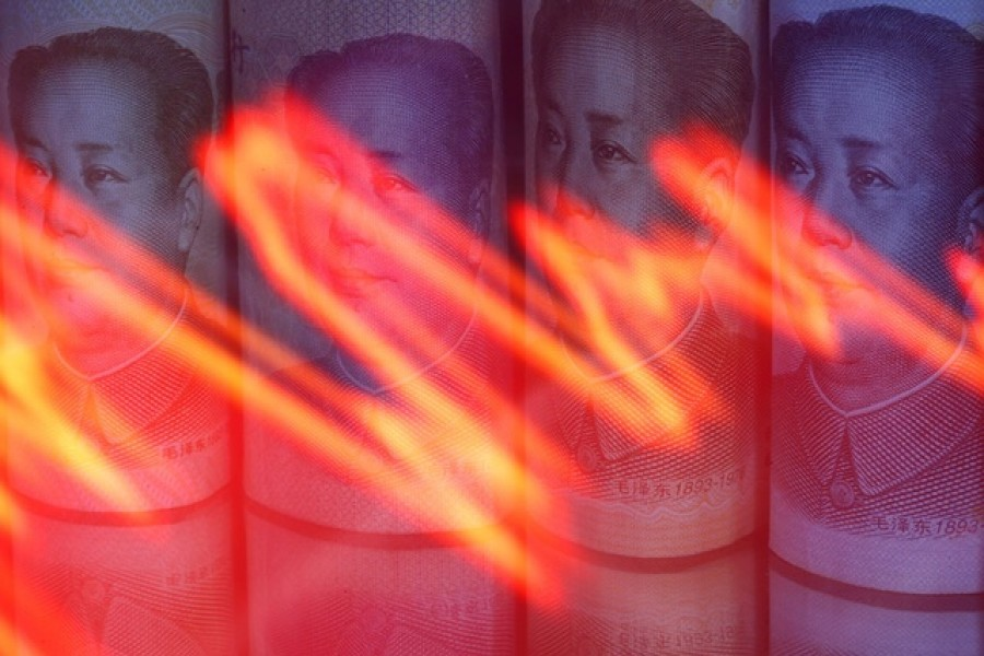 Chinese Yuan banknotes are seen behind illuminated stock graph in this illustration taken February 10, 2020. — Reuters