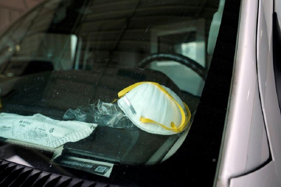 A protective face mask is seen on the dashboard of a REACT EMS ambulance in Shawnee, Oklahoma, US, amid a coronavirus disease (COVID-19) outbreak, April 02, 2020. — Reuters