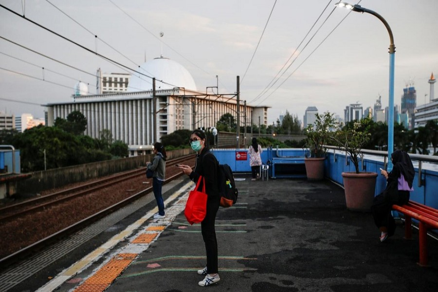A passenger wearing her protective face mask waits for her commuter train at a station amid the spread of coronavirus disease (COVID-19) outbreak in Jakarta, Indonesia, April 02, 2020. — Reuters