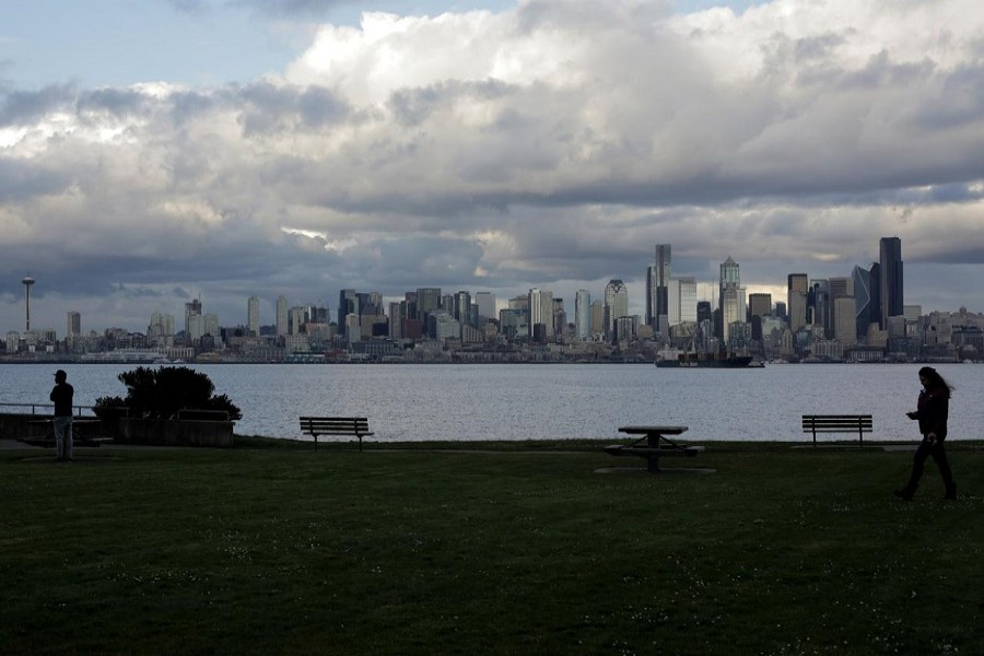 People practice social distancing while spending time outdoors in the West Seattle neighborhood during the coronavirus disease (COVID-19) outbreak in Seattle, Washington, US, April 02, 2020. — Reuters